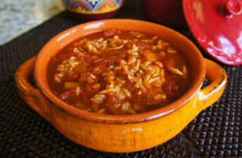 Whole grains enchilada soup with stewed tomatoes, salsa, shredded chicken and brown rice
