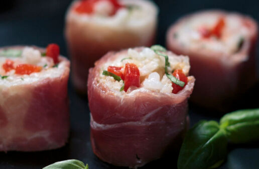Italian Sushi with arborio rice and red bell peppers rolled in prosciutto