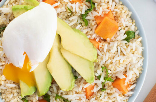 Grains breakfast bowl with jasmine rice, quinoa, poached eggs, avocado and sweet potato