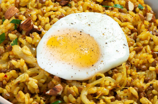 Spanish rice with lentils and a fried egg
