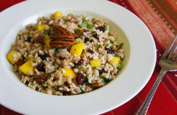 Whole grains rice salad with brown rice, mango, pecan and dried cranberries