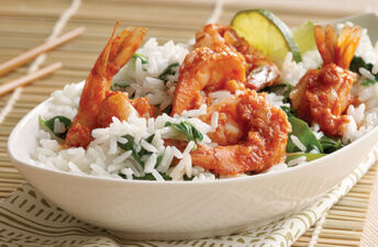Rice bowl with shrimp, coconut rice, spinach and lime