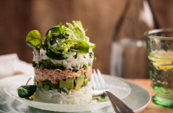 Jasmine Rice Towers with diced avocados, lettuce and spicy salmon