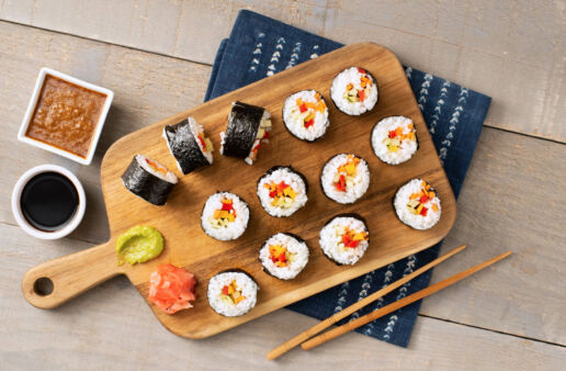 Vegetarian sushi rolls with nori, peppers, cucumber and wasabi