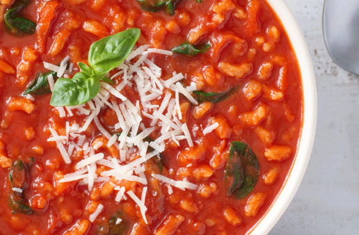 Tomato Rice Soup with cheese and basil