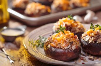 Wild Rice & Sausage Stuffed Mushrooms with cheese