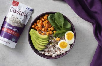 Breakfast rice bowl with turmeric rice, avocado and egg