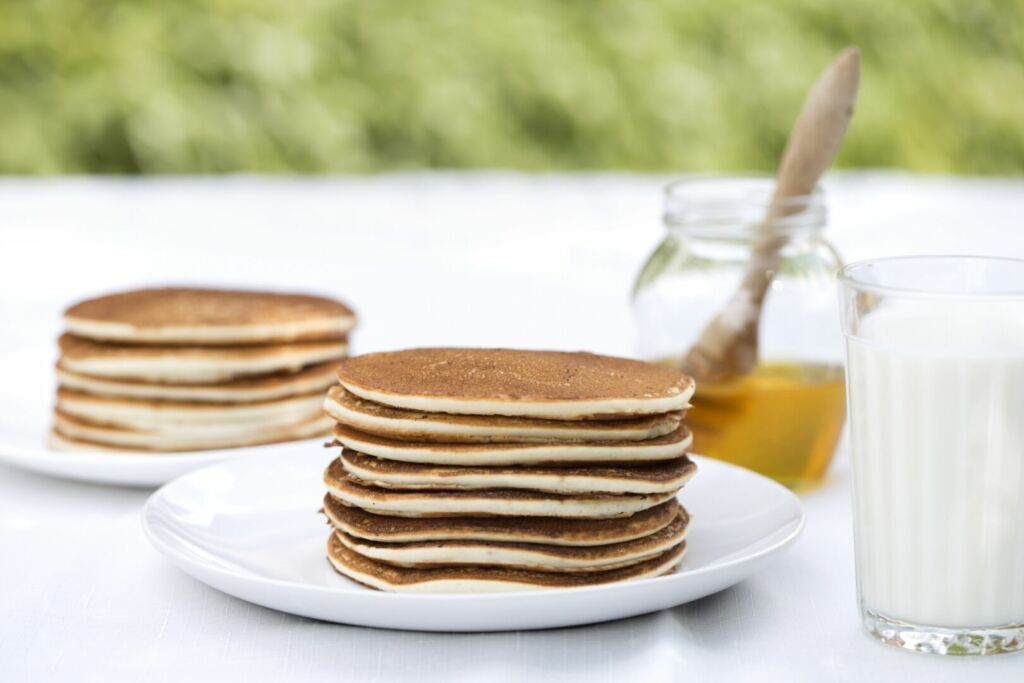Stack of fluffy rice pancakes with syrup