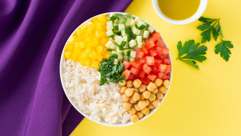 Rice and Chickpea Salad with Yellow Bell Pepper, Cucumbers and Tomatoes