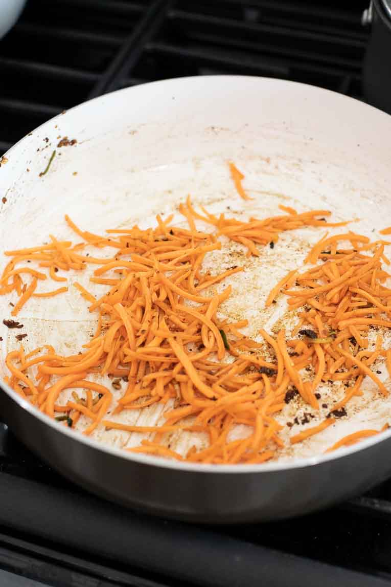 sauteeing sliced carrots