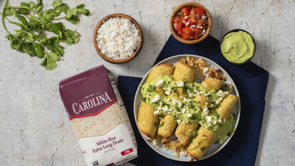 tacos-dorados-with-white-rice-chicken-avocado-cream-beans-and-tomatoes