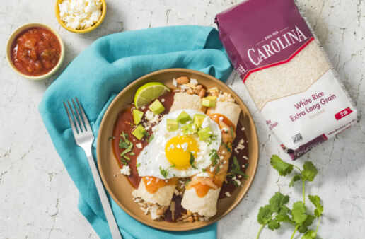 huevos-rancheros-enchiladas-filled-with-white-rice-chorizo-pinto-beans-and-topped-with-an-egg