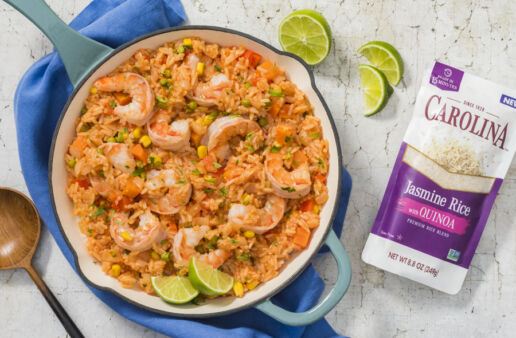 mexican-rice-and-quinoa-dish-with-shrimp-and-lime-wedges