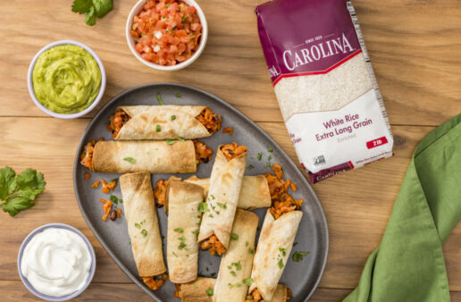 vegetarian-taquitos-with-black-beans-and-rice-served-with-guacamole-and-pico-de-gallo